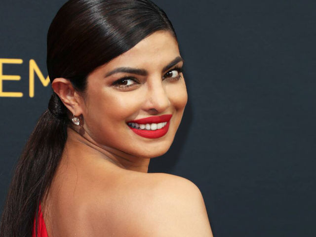 mumbai, Priyanka Chopra, shares sunkissed photo , fun red lipstick
